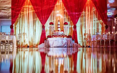 beautiful-reflection-of-wedding-dining-table-arrangement-with-gold-and-red-fabric-background_t20_BlvOgP